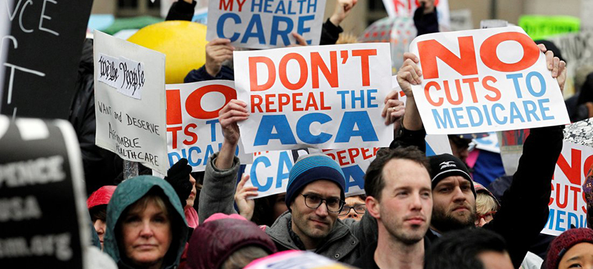 Demonstrators hold signs in support of the Affordable Care Act in Philadelphia on Jan. 25, 2017. (photo: Tom Mihalek/Reuters)