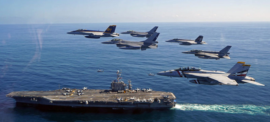 US Navy fighter jets flying side-by-side with Chilean Air Force fighter jets next to the USS George Washington aircraft carrier. (photo: US Navy)