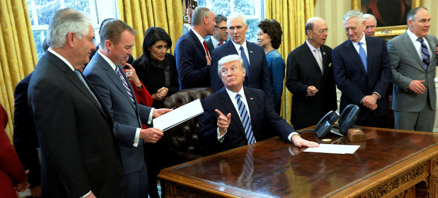 Trump administration officials at the Oval Office. (photo: Jonathan Ernst/Reuters)