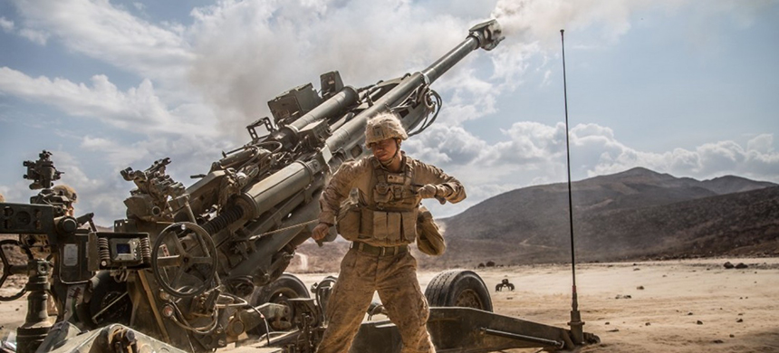 U.S. Marines with Alpha Battery, Battalion Landing Team 1st Bn., 4th Marines, fire their M-777 lightweight 155mm howitzer on Dec. 18. (photo: Lance Cpl. Zachery C. Laning/Marine Corps)