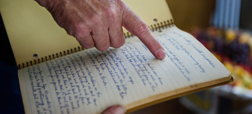 Man points to writing in a journal. (photo: Amanda Voisard/The Washington Post)