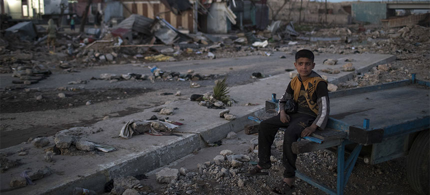A boy amid the ruins in West Mosul, April 2017. (photo: Felipe Dana/AP)