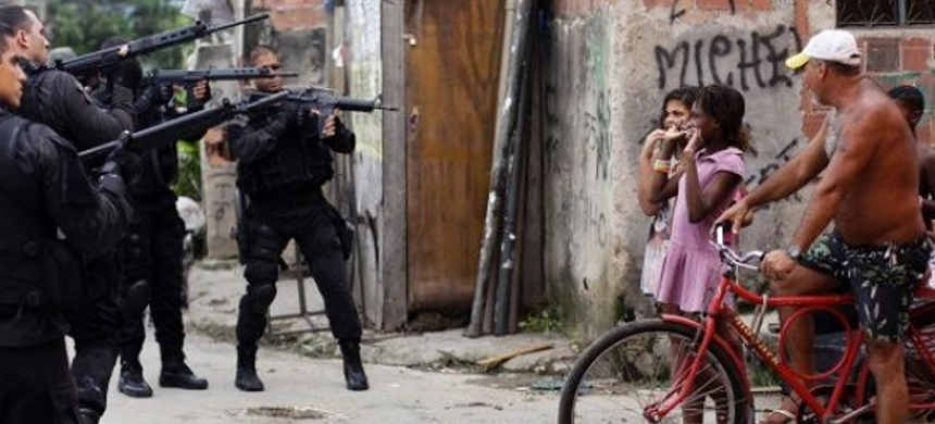 Frequent police brutality has undermined the trust of residents of Rio de Janeiro's Maré favela in law enforcement. (photo: Reuters)