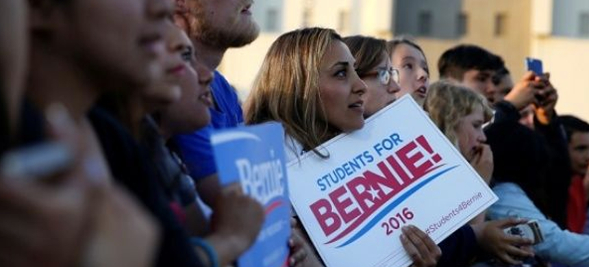 Students listen to a Bernie Sanders speech. (photo: Reuters)