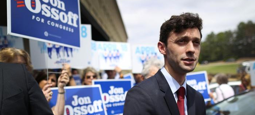 Jon Ossoff speaks to the media during a visit to a campaign office. (photo: Joe Raedle/Getty Images)