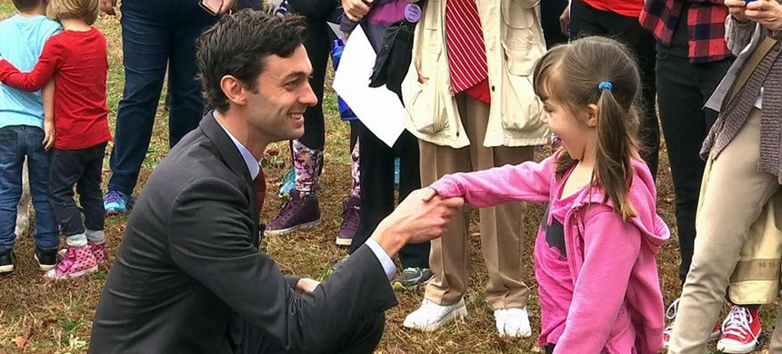 Democratic congressional candidate Jon Ossoff is seen with supporters outside of the East Roswell Branch Library in Roswell, Georgia, on the first day of early voting. (photo: Alex Sanz/AP)