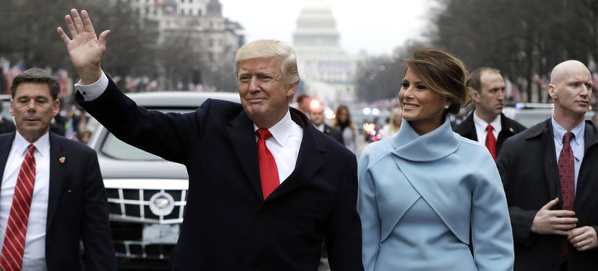 President Trump waves to supporters as he walks the parade route with first lady Melania Trump after being sworn in on Jan. 20. (photo: Getty)
