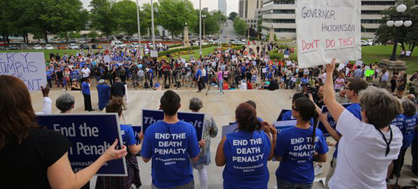 People gather at a rally opposing Arkansas' upcoming executions on Friday in Little Rock. (photo: Stephen B Thornton/AP)