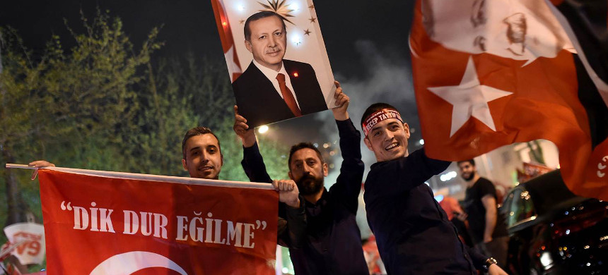 Supporters of Turkish president Recep Tayyip Erdogan during a rally near the headquarters of the conservative Justice and Development Party (AKP) on April 16 in Istanbul. (photo: Ozan Kose/Getty)