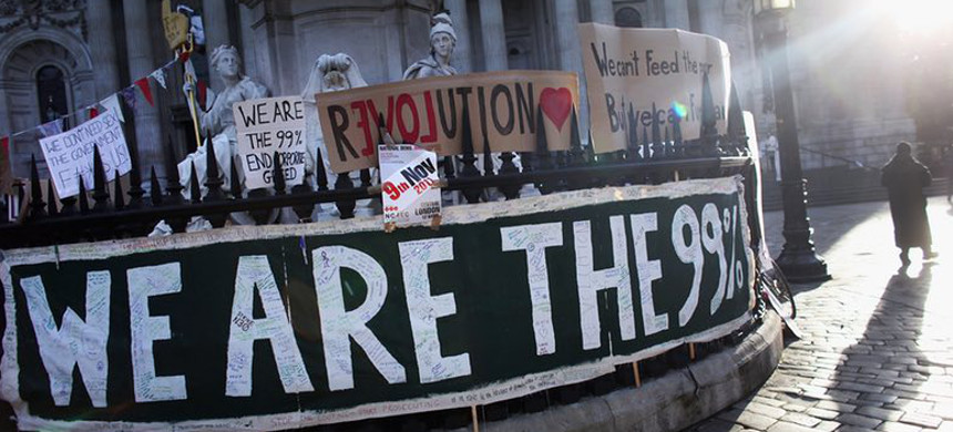 An Occupy protest in London, 2011: the extreme rise in inequality levels gave the movement its motto. (photo: Oli Scharff/Getty)