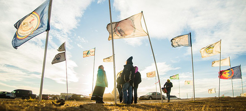 Flags fly at the Oceti Sakowin Camp in 2016, near Cannonball, North Dakota. (photo: Lucas Zhao/CCbyNC)