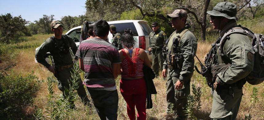 US Border Patrol agents arrest immigrants attempting to enter the US. (photo: ABC News)
