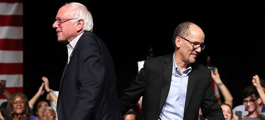 Senator Bernie Sanders and Democratic National Committee Chair Tom Perez walk past each other during their 'Come Together and Fight Back' tour at the James L. Knight Center on Wednesday in Miami, Florida. (photo: Joe Raedle/Getty Images)