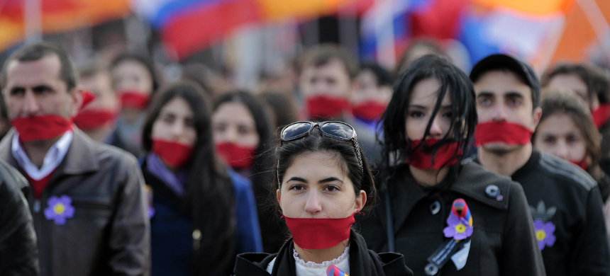 Demonstrators take part in an event to mark the Armenian genocide. (photo: AFP)