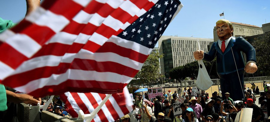 Members of the 'Full Rights for Immigrants Coalition' displayed a giant effigy of then-candidate Donald Trump on May Day in Los Angeles last year. (photo: Mark Ralston/AFP/Getty Images)