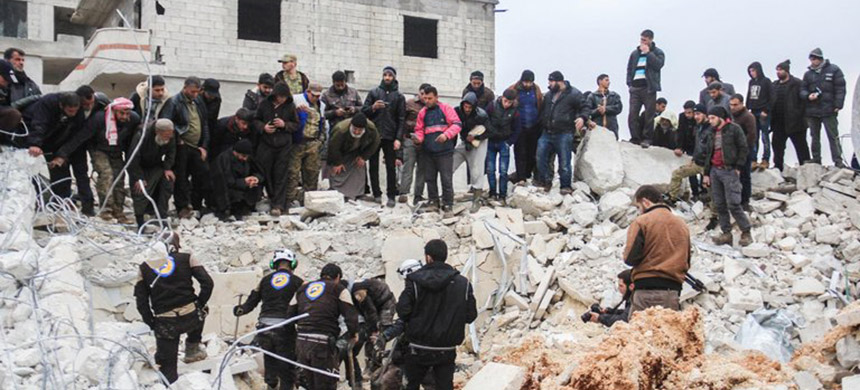 Civil defense volunteers dug through the rubble of a mosque in the Syrian village of Al Jinah after an American airstrike in March. (photo: Omar Haj Kadour/AFP/Getty Images)