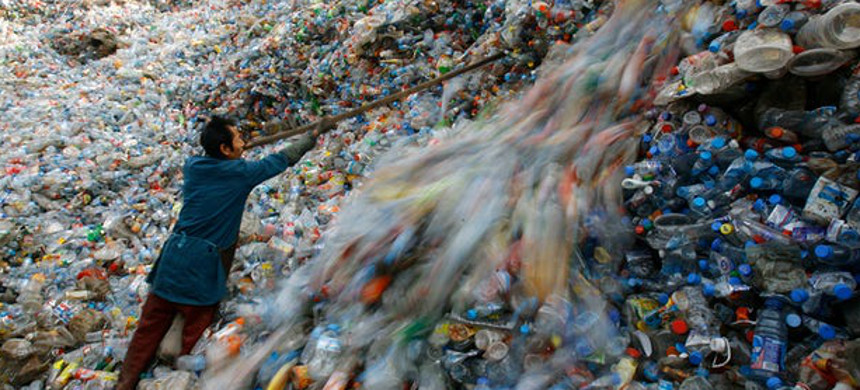 A worker sorts plastic bottles at a recycling center on the outskirts of Wuhan, Hubei province in China. (photo: Jie Zhao/Getty)