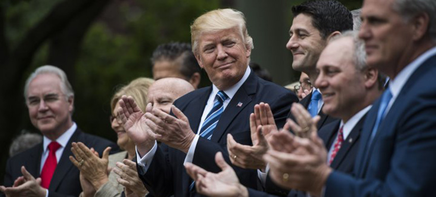 President Donald Trump looks to House Speaker Paul Ryan of Wisconsin and other House congressmen in the Rose Garden after the House pushed through a health care bill, at the White House in Washington, D.C., May 04, 2017. (photo: Jabin Botsford/Getty Images/WP)