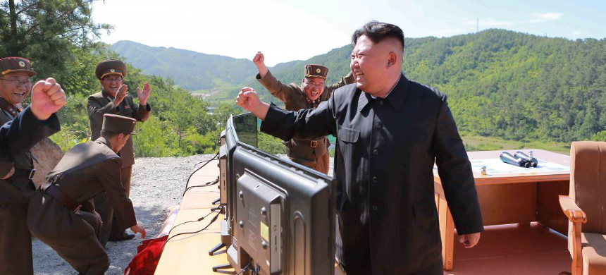 North Korean Leader Kim Jong Un reacts during the test-fire of intercontinental ballistic missile Hwasong-14 in this undated photo. (photo: KCNA)