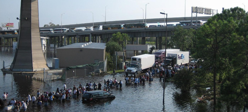 African American residents of New Orleans wade through the flooded streets after Hurricane Katrina. (photo: Reuters)