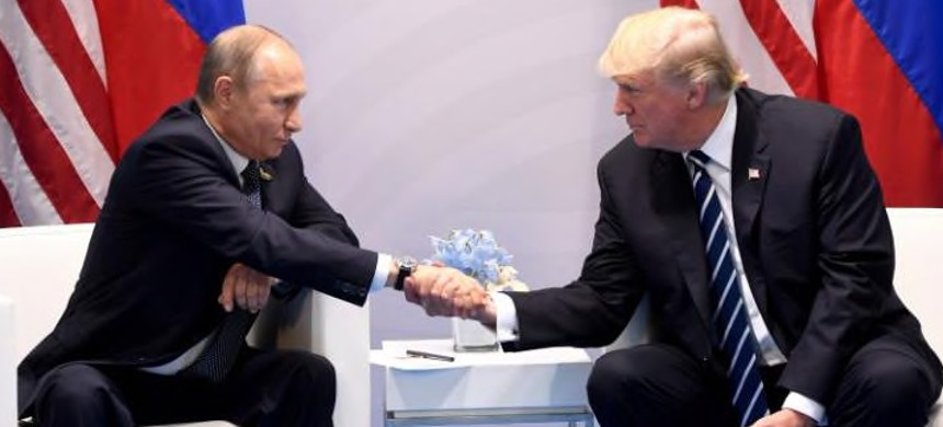 U.S. president Donald Trump and Russia's president Vladimir Putin shake hands during a meeting on the sidelines of the G20 Summit in Hamburg. (photo: Saul Loeb/Getty)