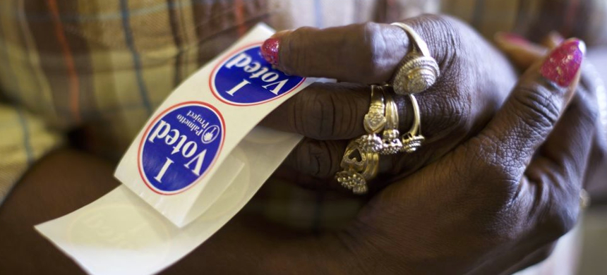 Former members of the vote-suppressing Bush 43 Justice Department are engaged as private citizens in money-whipping poor - and largely minority - counties into purging their voter rolls. (photo: Getty Images)