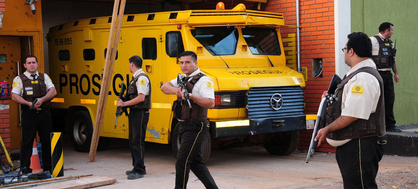 Guards from the private security company Prosegur after the Paraguay-based firm was targeted in a multimillion-dollar raid in April. (photo: Reuters)