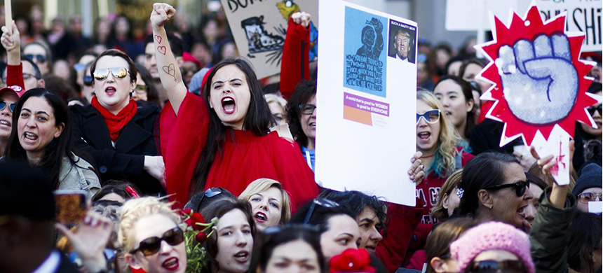 Activists gather for a rally and march marking International Women's Day. (photo: Justin Lane/EPA)