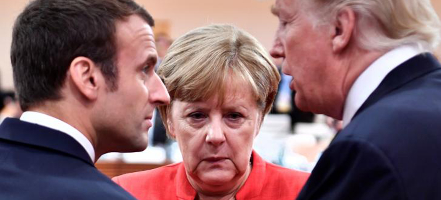 French President Emmanuel Macron, German Chancellor Angela Merkel and U.S. President Donald Trump confer at the start of the first working session of the G20 meeting in Hamburg, Germany, July 7, 2017. (photo: John MacDougall/Reuters)