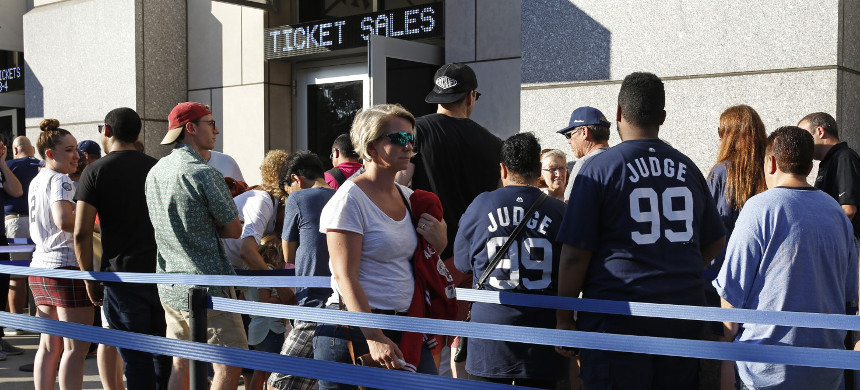 People wearing Aaron Judge jerseys wait with other fans to purchase baseball tickets. (photo: Kathy Willens/AP)