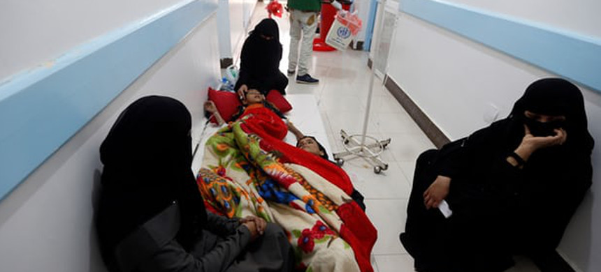 Yemenis, suspected of being infected with cholera, receiving treatment at a hospital in the capital Sana'a. (photo: Mohammed Hawais/Getty)