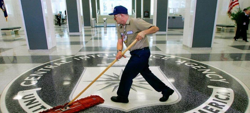 A worker slides a mop over the floor at the entrance to the Central Intelligence Agency in this 2005 photo. (photo: J. Scott Applewhite/AP)