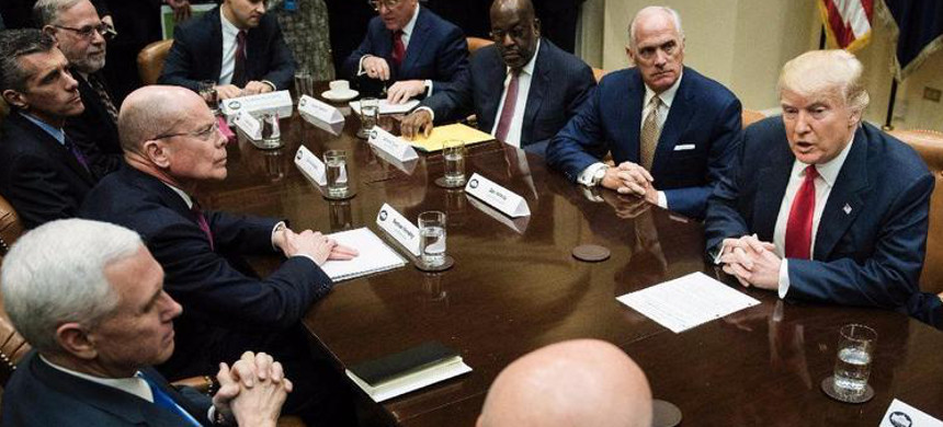 President Trump meets in February with the heads of major health insurers. Many industry officials and state regulators now believe they cannot rely on Trump to effectively manage the country's insurance markets. (photo: AFP/Getty)