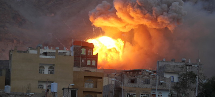 A Saudi airstrike explodes near civilian homes in Yemen. (photo: Mohamed al-Sayaghi/Reuters)