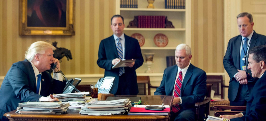 President Donald Trump is joined by Vice President Mike Pence and senior staff in the Oval Office. (photo: Andrew Harnik/AP)