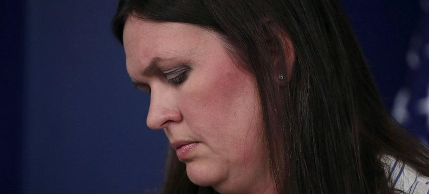 White House Deputy Press Secretary Sarah Huckabee Sanders makes excuses for the Don Jr. meeting at a press briefing on Wednesday in Washington. (photo: Getty Images)