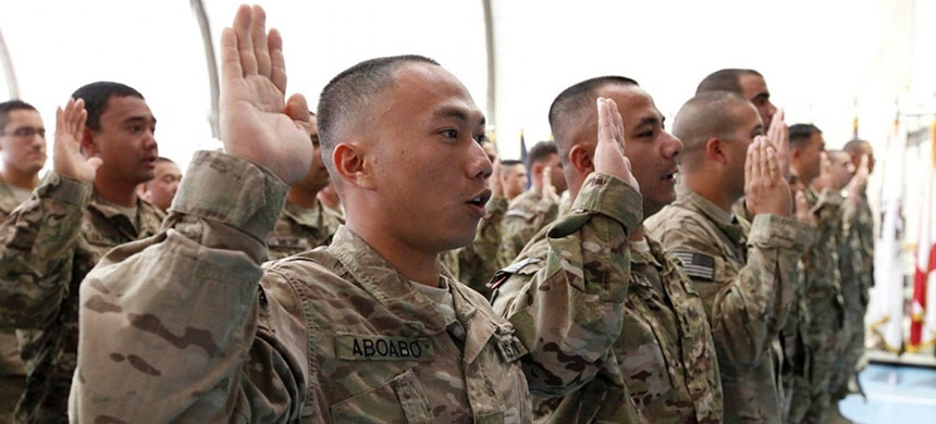 U.S. troops are sworn in as naturalized citizens on Nov. 2, 2012, at Bagram Airfield in Afghanistan. (photo: State Department)