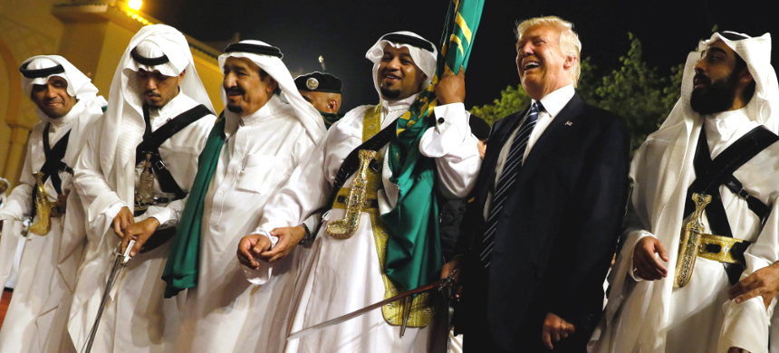 U.S. president Donald Trump dances with a sword as he arrives to a welcome ceremony by Saudi Arabia's King Salman bin Abdulaziz Al Saud at Al Murabba Palace in Riyadh, Saudi Arabia, May 20, 2017. (photo: Thomson Reuters)