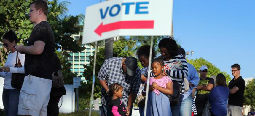 Voters line up to cast their ballots. (photo: Getty)