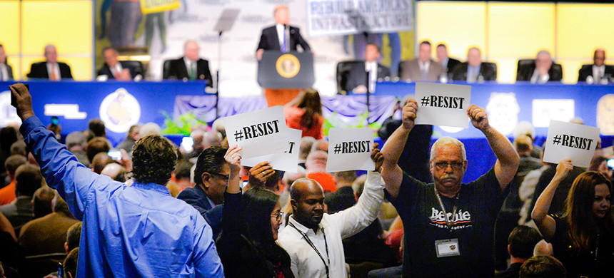 Building Trades Union members protest Trump's presence at their annual conference in April. (photo: Oliver Douliery/Getty)