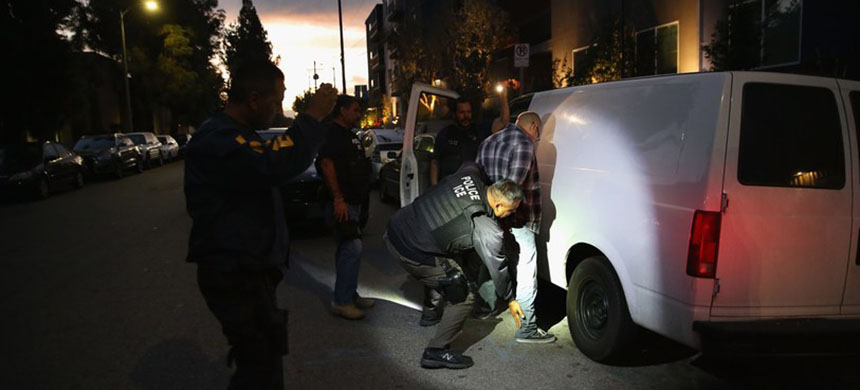 Immigration and Customs Enforcement detains a man in Los Angeles, in October, 2016. Since Donald Trump took office, three months later, the agency's hard line has worried some employees. (photo: John Moore/Getty Images)