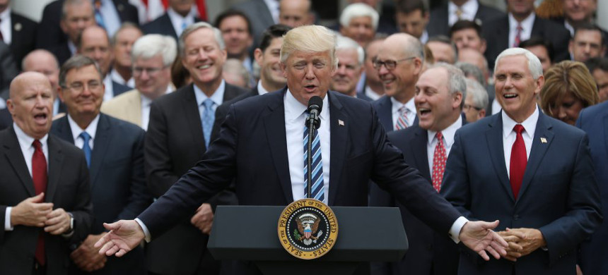 Donald Trump and the Republican members of the House of Representatives at the White House. (photo: Getty)