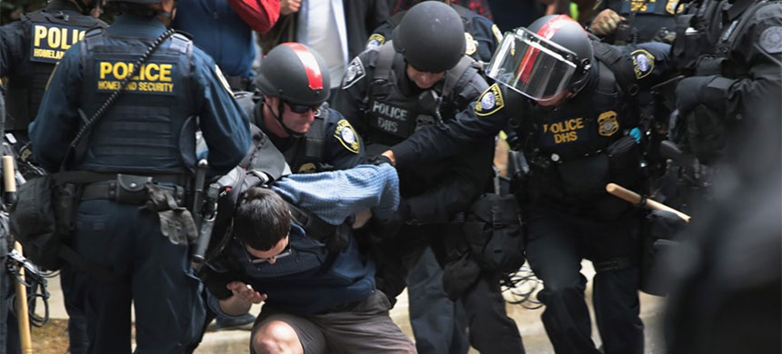 Department of Homeland agents (DHS) acting as police arrest a counter protester at a right-wing, pro-Trump rally in Portland. (photo: Scott Olson/Getty Images)