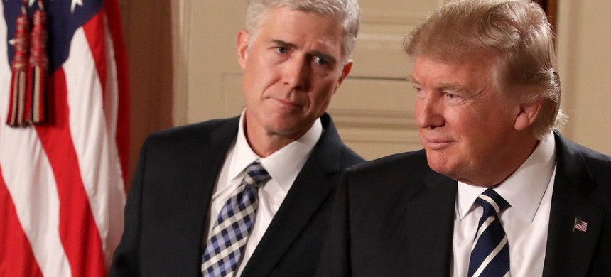 Donald Trump with Supreme Court Justice Neil Gorsuch. (photo: Chip Somodevilla/Getty)