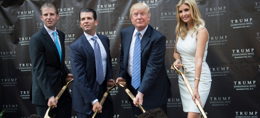 American business magnate Donald Trump (2-R), his sons Eric Trump (L) and Donald Trump Jr. (2-L), and daughter Ivanka Trump (R) pose for photographers during the ground breaking ceremony of the Trump International Hotel project at the Old Post Office. (photo: Getty)