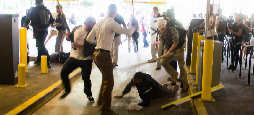 Four neo-Nazis beat black school teacher De'Andre  Harris with iron bars and lumber. (photo: Zach D Roberts)