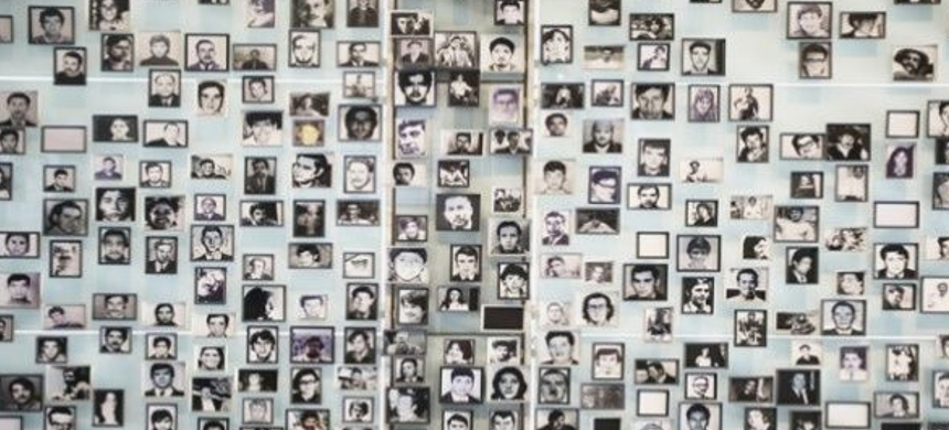 Victims of the Pinochet dictatorship displayed on a wall. (photo: EFE)