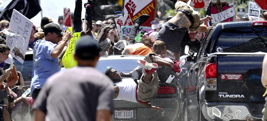 A car plows into pedestrians and vehicles on the mall in Charlottesville during a white supremacist rally. The driver hit the knot of cars and people at high speed, then backed up and fled the scene. (photo: AJC)