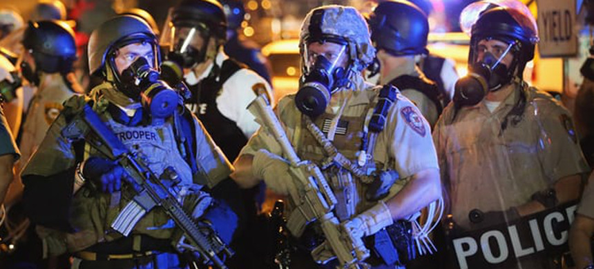 Police with military-style assault weapons. (photo: Scott Olson/Getty)