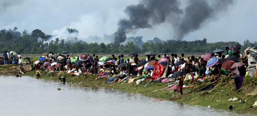 Villagers who fled attack and crossed border into 